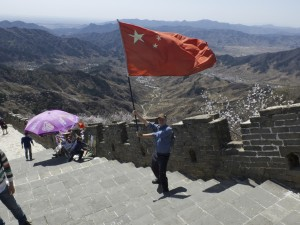 Waving the flag at the Great Wall of China