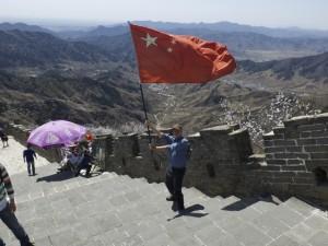 Waving the flag at the Great Wall of China