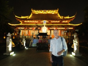 Tim and the statue of Confucius at a shrine in a market place in Nanjing